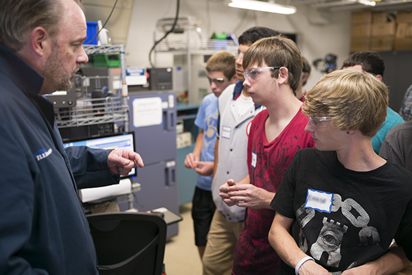 Engineer Talking to Students