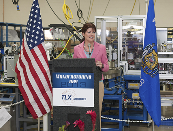 Woman Speaking at TLX Technologies Open House