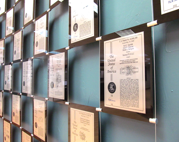 TLX patents hanging on wall